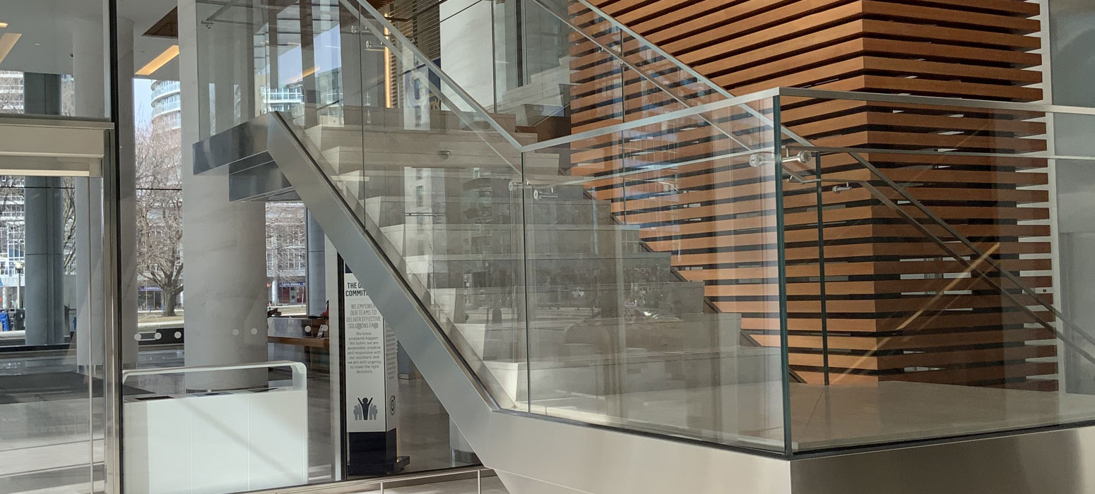 metal stairs with glass rail
